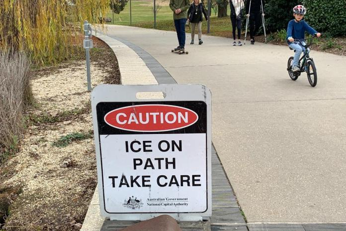 Ice on path take care sign