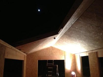 Full moon over half built roof