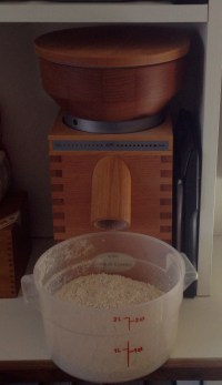 Sun-powered grain grinder making 100% whole wheat flour