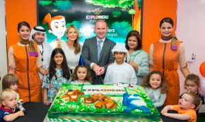 Turky Alhammadi, Etihad Airways Manager Product – Guest Experience, Linda Celestino, Etihad Airways Vice President Guest Services, Calum Laming, Etihad Airways Vice President Guest Experience, and Sajida Ismail, Vice President Service and Hospitality, cutting the cake in celebration of the launch of the new Etihad Explorers children's activity kits and the new Flying Nanny kit.