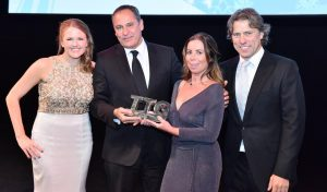 James Harrison, UK General Manager for Etihad Airways (second from left) receives the award from Pippa Jacks, Editor of TTG, Stefanie Bowes of Birmingham Airport and Comedian and Host of the TTG Awards, John Bishop.