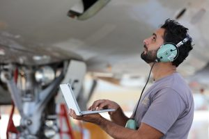 An Etihad Airways Engineering engineer carries out a maintenance check on an aircraft