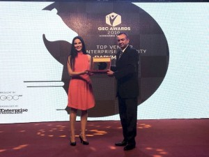 Harshul Joshi (right), Senior Vice President of Cyber Governance, Risk & Compliance, receiving the 'Top Vendor - Enterprise Security' award on behalf of DarkMatter at the GEC Awards 2016 in Dubai (PRNewsFoto/DarkMatter)