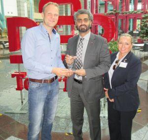 Mr. Philipp Herbruegger with Mr Khoori and Ms Deininger