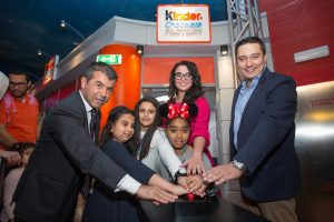 The KidZania management team and the winners of the golden ticket.