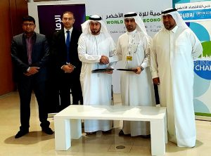 (3rd and 4th from left) Fahad Al Zarouni, Vice President – Priority Banking , Emirates Islamic and Fahad Al Gergawi, Secretary General, Green Economy Partnership. CEO, Dubai FDI at the signing ceremony.