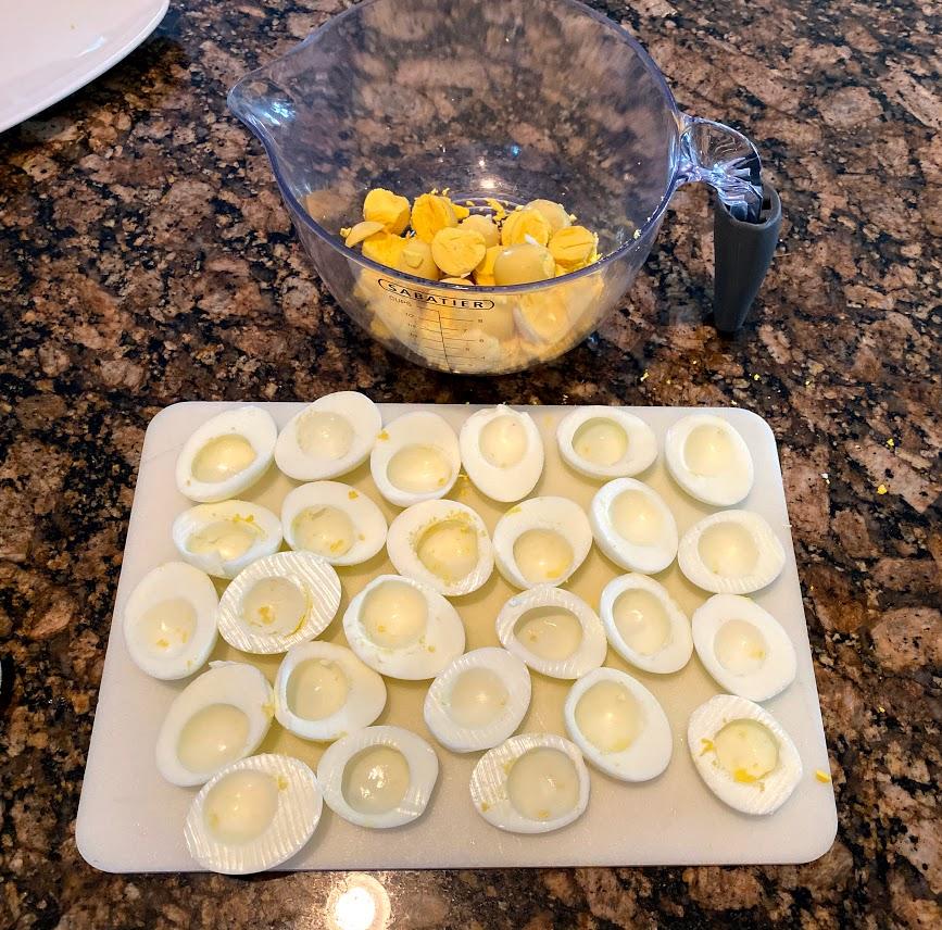 Egg halves with yolks removed for Deviled Eggs