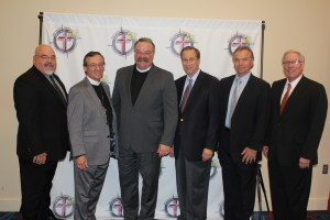 The president and vice presidents of the Mid-South District commemorated the evening through a photo with LCMS President, Rev. Dr. Matthew Harrison, the banquet's special guest speaker. Pictured are (L to R) Rev. Paul Hass, Rev. Dr. Roger Paavola, Rev. Dr. Matthew Harrison, Rev. Jim Walter, Rev. Charles Neugebauer and Rev. Rich Elseroad.