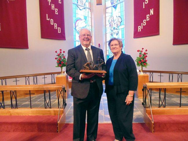 Don Israel accepts award-