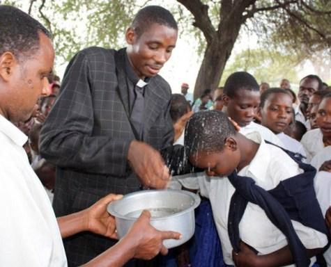 Pastor Medard performs baptism, Tanzania mission trip
