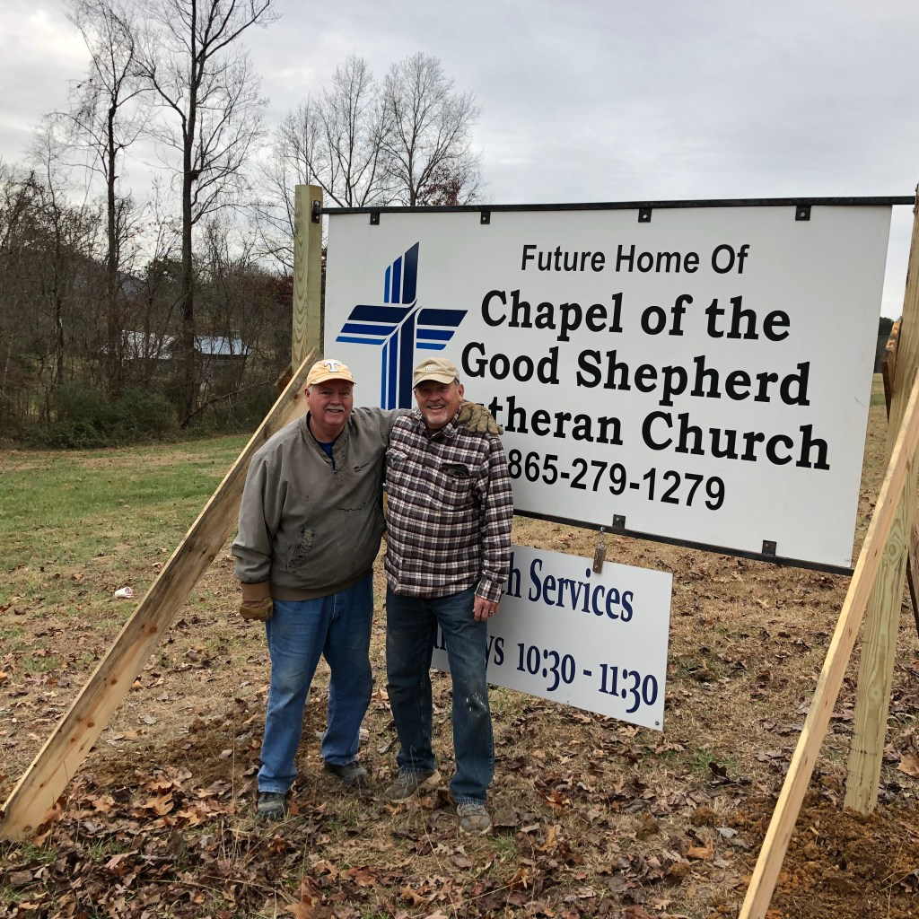 Jeff Landis and Jeff Garretson  installed sign to proclaim the site as Chapel of the Good Shepherd's future home