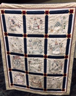 Handmade quilt presented to Pastor Andrew