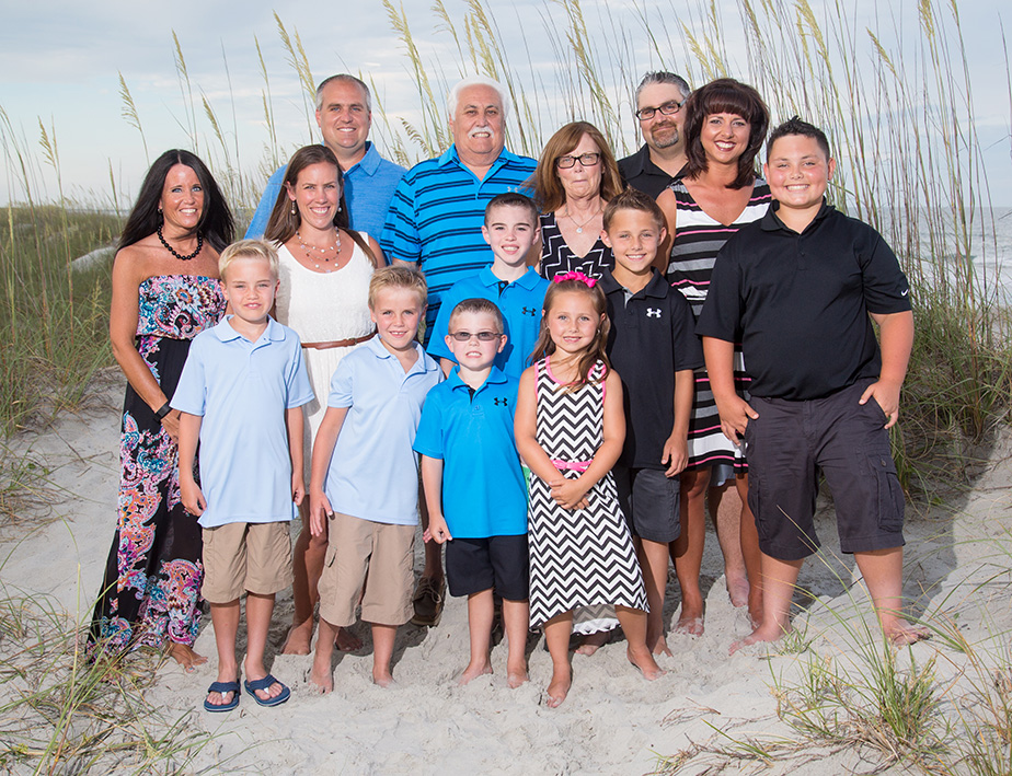 Myrtle Beach Photography - Large Family photo standing outside at a beach