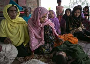 ohingya women and children rest after crossing into Bangladesh at Cox's Bazar on Friday, a day after the two governments signed a refugee repatriation deal. Photograph: Allison Joyce/Getty Images