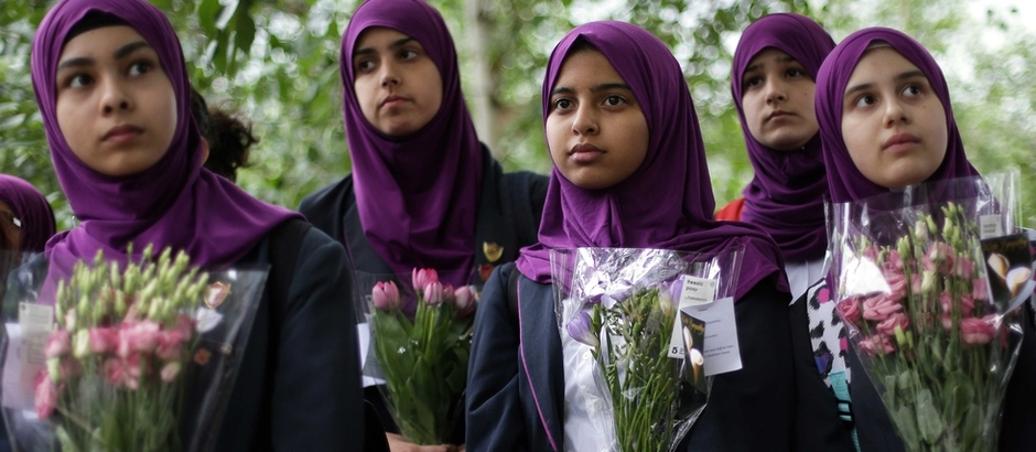 Pupils from Eden Girls' School vigil at Potters Fields Park London on June 5 2017 to commemorate victims of London Bridge and Borough Market AFP