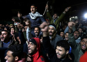 Palestinians react during a protest against U.S. President Donald Trump's decision to recognise Jerusalem as Israel's capital, in Khan Younis in the southern Gaza Strip December 6, 2017. REUTERS/Ibraheem Abu Mustafa
