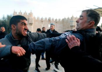Israeli police square up to a Palestinian protester outside Damascus Gate/AFP