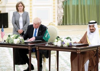 Saudi King Salman and US President Donald Trump take part in a signing ceremony at the Royal court in Riyadh/AFP