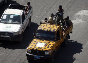 Huthi fighters patrol a street in the Yemeni capital Sanaa on December 3, 2017, during clashes with supporters of Yemeni ex-president Ali Abdullah Saleh.