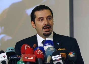 "Lebanese Prime Minister Saad Al-Hariri gives a speech during the pening ceremony of the second ""Kuwait Financial Forum"" in Kuwait City on October 31,2010/AFP"