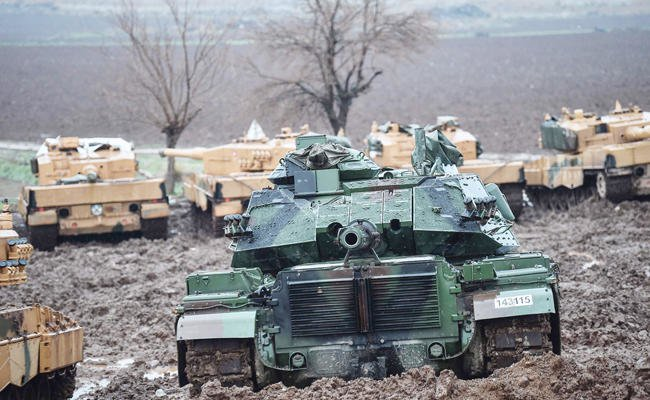"Turkish tanks have been stationed near the Syrian border as part of the operation ""olive Branch"" that aims to oust the People's Protection Units (YPG) militia from its enclave of Afrin/AFP"