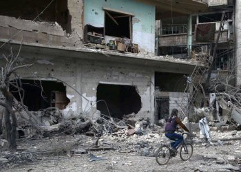 As the bombs rain down, rescuers struggling to pull people from the rubble in Eastern Ghouta, Syria. (Reuters)