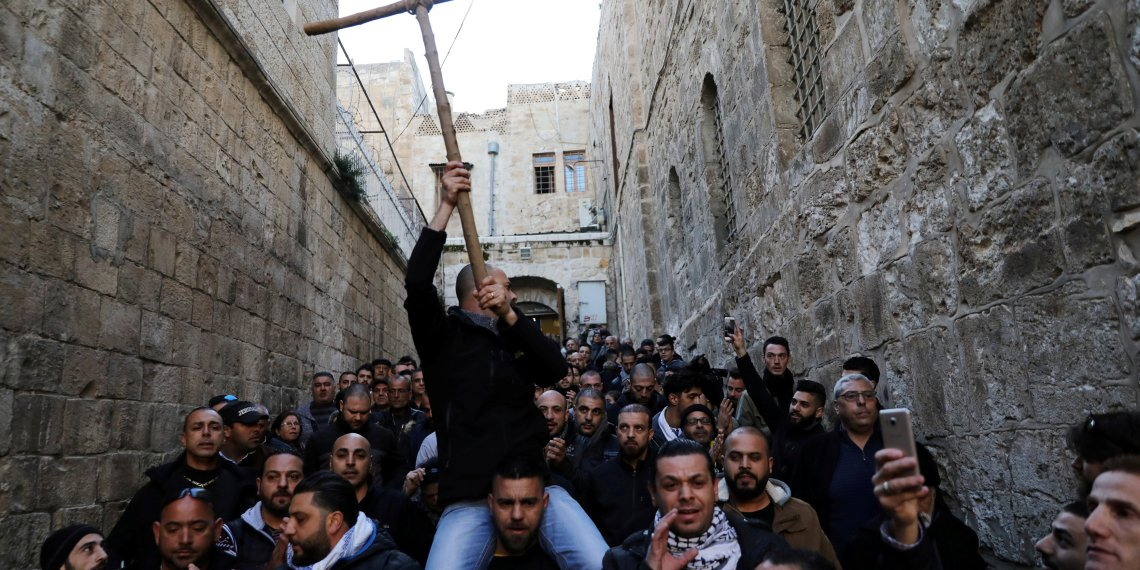 Worshippers shout slogans during a protest near the closed entrance to the Church of the Holy Sepulchre in Jerusalem's Old City, February 27, 2018. REUTERS/Ammar Awad