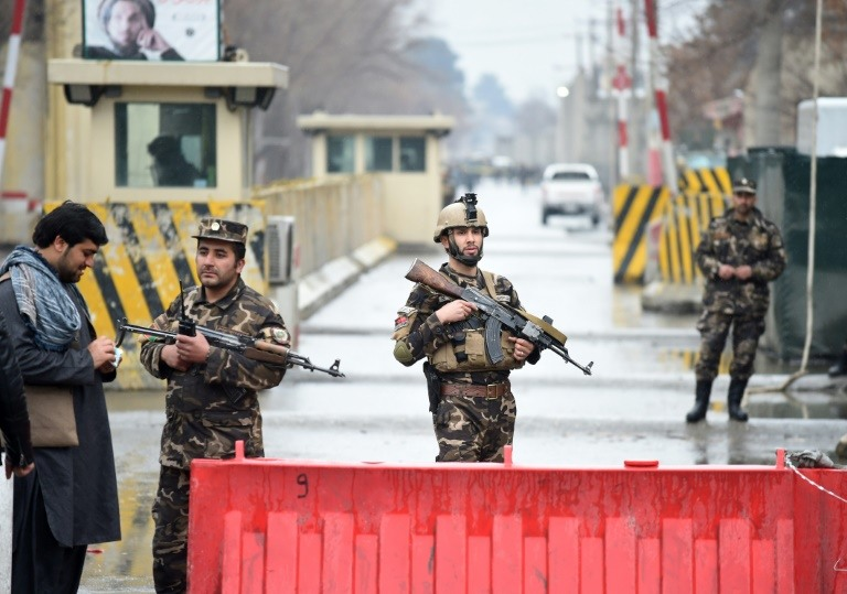 Afghan security personnel seal off the site of a suicide attack near the diplomatic area of Kabul. /AFP / WAKIL KOHSAR