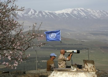 UN workers monitor the Israel-Syria border in the Israeli-annexed Golan Heights AFP / JALAA MAREY
