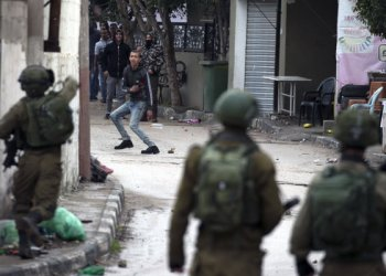 Israeli forces clash with Palestinian youths Jan. 18 during military operation in Jenin, in the north of the occupied West Bank,. /AFP