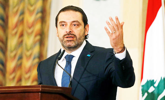 Lebanese Prime Minister Saad al-Hariri gestures during a donor conference in Beirut, Lebanon on Thursday/REUTERS