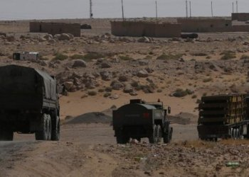 Russian military-type trucks on the road heding to Deir Ezzor in Kabakeb, Syria/REUTERS