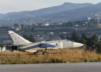 A Sukhoi Su-24 fighter jet taxis on tarmac at the Hmeymim air base near Latakia, Syria, in this file handout photograph released by Russia's Defence Ministry November 11, 2015. REUTERS/Ministry of Defence of the Russian Federation/Handout via Reuters
