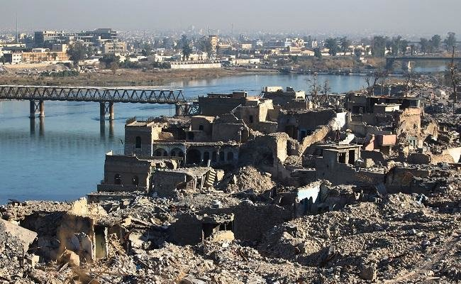Above, destruction at the old city of Mosul with the city's old bridge over the Tigris river in the background, on January 9, 2018. (Reuters)