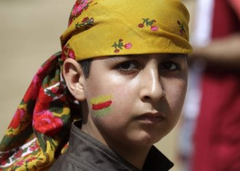 A Lebanese Kurdish boy is seen during a gathering to celebrate Nowruz, the Kurdish New Year, in the capital Beirut on Wednesday. (AFP)