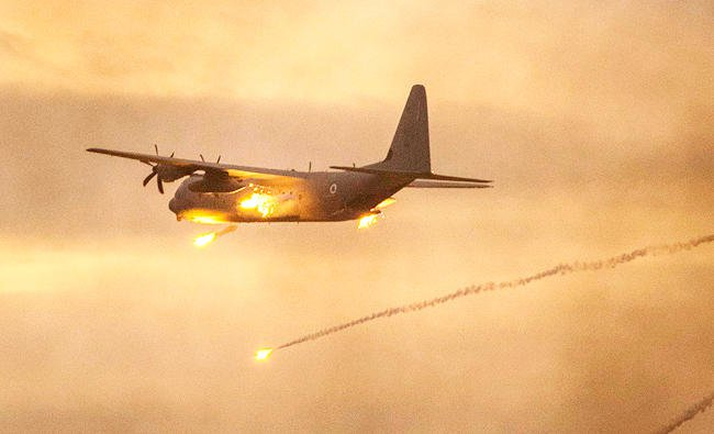 An Israeli C-130 Hercules plane launches anti-missile flares near the southern Israeli city of Beer Sheva, in this December 27, 2017 file photo. (AFP)