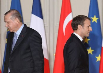 Turkish President Recep Tayyip Erdogan accuses French President Emmanuel Macron of overstepping 'his limits' and going 'over his head.' (File/AFP)