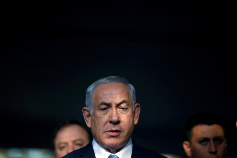 FILE PHOTO: Israel's Prime Minister Benjamin Netanyahu attends a memorial ceremony for the late prime minister Yitzhak Rabin at Mount Herzl military cemetery in Jerusalem as Israel marks the 22nd anniversary of Rabin's killing by an ultra-nationalist Jewish assassin, November 1, 2017. REUTERS/Ronen Zvulun/File Photo