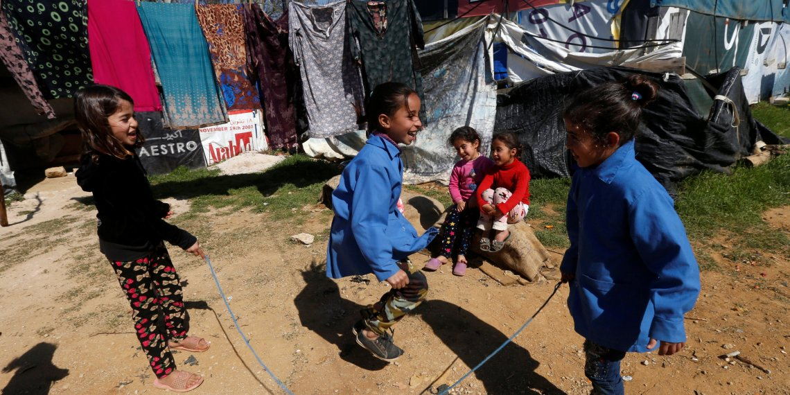 Syrian refugee children play at a tented settlement in the town of Qab Elias, in Lebanon's Bekaa Valley, March 13, 2018. Picture taken March 13, 2018. REUTERS/Mohamed Azakir