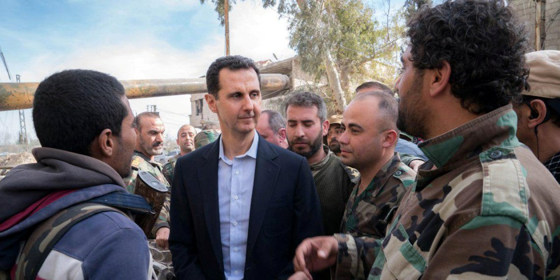 Syrian President Bashar al-Assad meets with Syrian army soldiers in eastern Ghouta, Syria, March 18, 2018. SANA/Handout via REUTERS