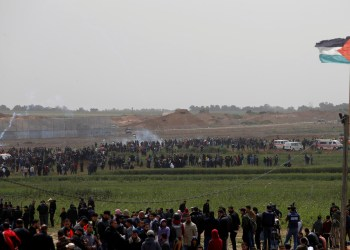 Palestinians gather during a protest marking Land Day and the first anniversary of a surge of border protests, at the Israel-Gaza border fence east of Gaza City March 30, 2019. REUTERS/Mohammed Salem