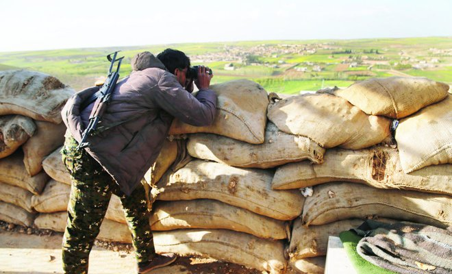 The front line of Halawanji village, north of Manbij town in Syria, was tense on Friday as Turkey threatened to advance on the town to clear it of the US-backed fighters. (AP)