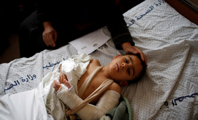 A Palestinian boy who was wounded at the Israel-Gaza border reacts at al-Shifa hospital in Gaza City April 1, 2018. (Reuters)