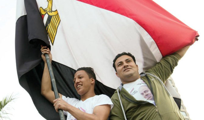 Supporters of President Abdel Fatah El-Sisi Celebrate in Mustafa Mahmoud square after the election commission announced the Presidential election results in Cairo on Monday/ AP