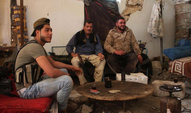 Opposition fighters rest as they guard a position in a destroyed building in a rebel-held area in the southern Syrian city of Daraa. As loyalist forces mop up the last pockets of resistance around the capital, President Bashar Assad appears to already have set his sights on Daraa. (AFP)