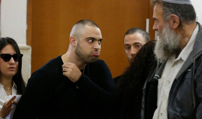 Ben Deri, a 24-year-old Israeli policeman accused of killing a Palestinian teenager in 2014 during clashes in Beitunia in the occupied West Bank, is seen at the district court in Jerusalem on April 25, 2018. (AFP)
