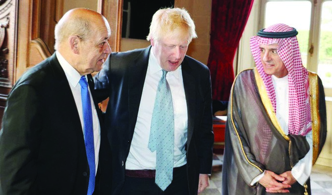 Saudi Arabia's Foreign Minister Adel Al-Jubeir with UK FM Boris Johnson and French Foreign Minister Jean-Yves Le Drian in Paris on Friday. (SPA)