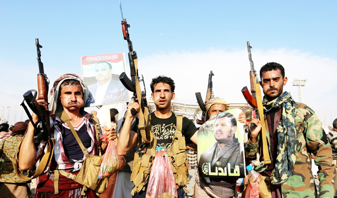 Houthi supporters hold up rifles as they rally to protest the killing of Saleh Al-Samad in Sanaa, Yemen, on Wednesday. Reuters