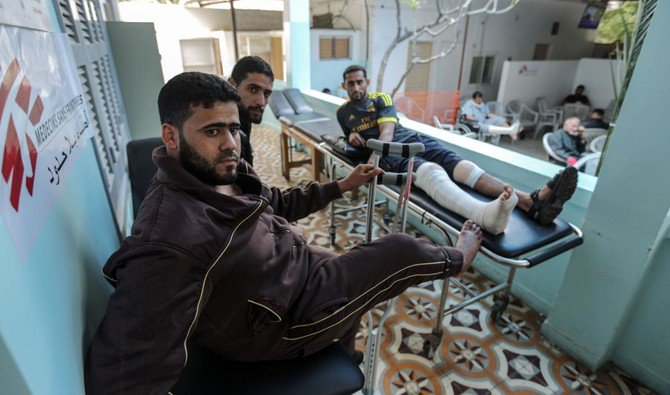 """Palestinians, wounded in previous weeks during mass protests against Israeli forces along the border of the Palestinian enclave, dubbed """"The Great March of Return,"""" await medical check-up at the Doctors Without Borders (MSF) clinic in Gaza City on April 25, 2018. (AFP)"""