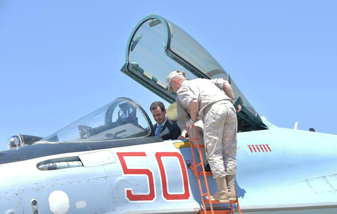 FILE PHOTO: Syria's President Bashar al-Assad visits a Russian air base at Hmeymim, in western Syria in this handout picture posted on SANA on June 27, 2017, Syria. SANA/Handout via REUTERS/File Photo